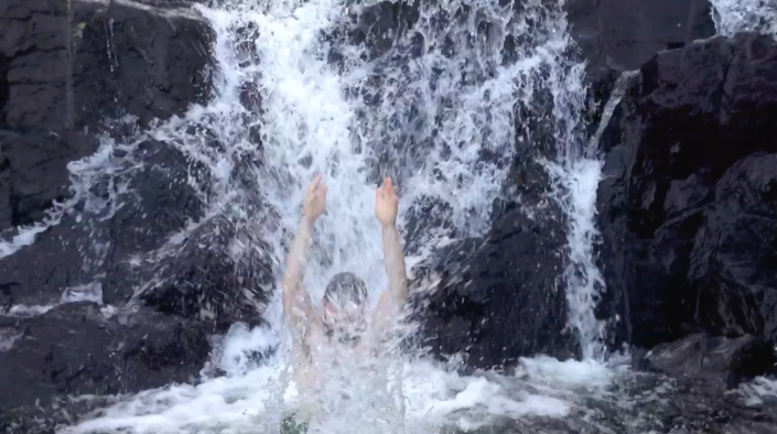 Gee having a splash in a waterfall on the East Coast Trail, Newfoundland.