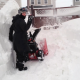 Cee snow blowing the 6 foot high drifts.