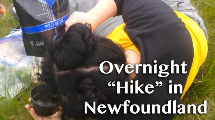 "Overnight ""hike"" in Newfoundland title over an image of Cee drinking out of a bag of wine."
